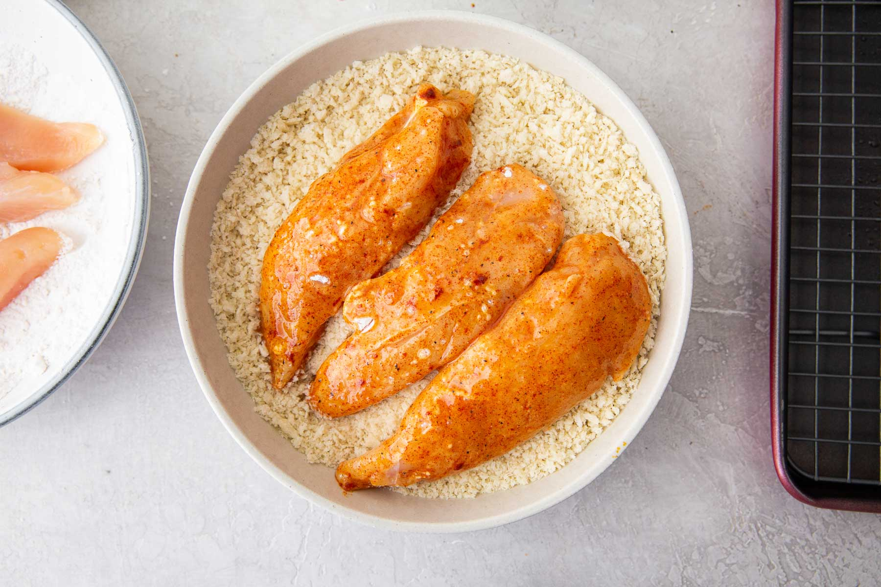 coating chicken in panko bread crumbs