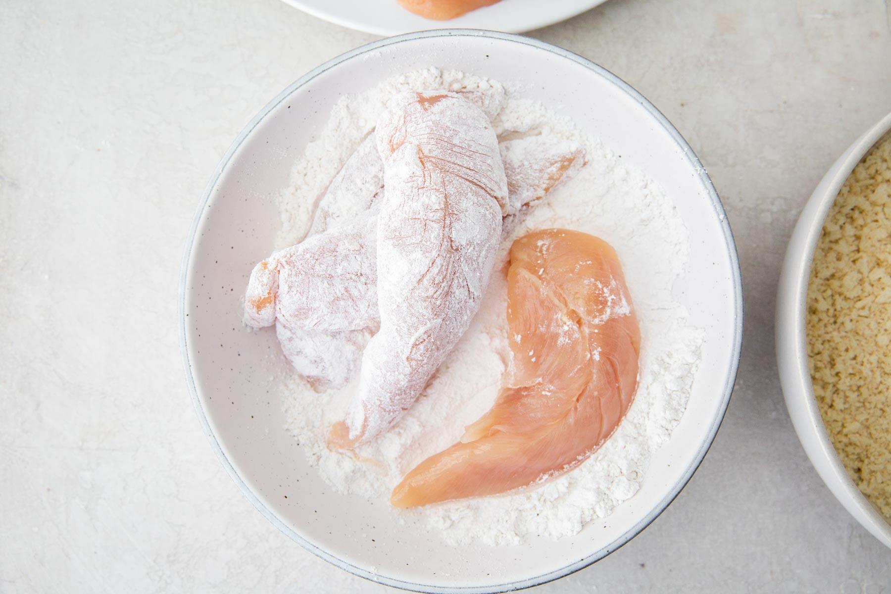 coating chicken in flour
