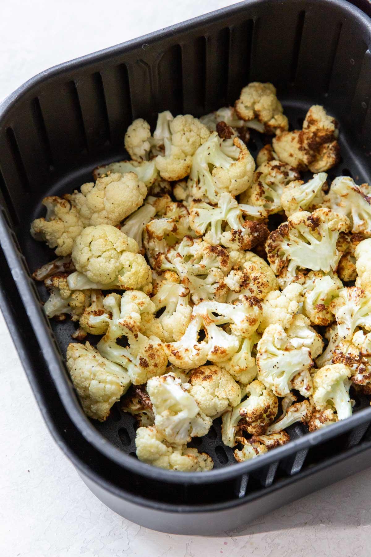 air fried cauliflower in air fryer basket