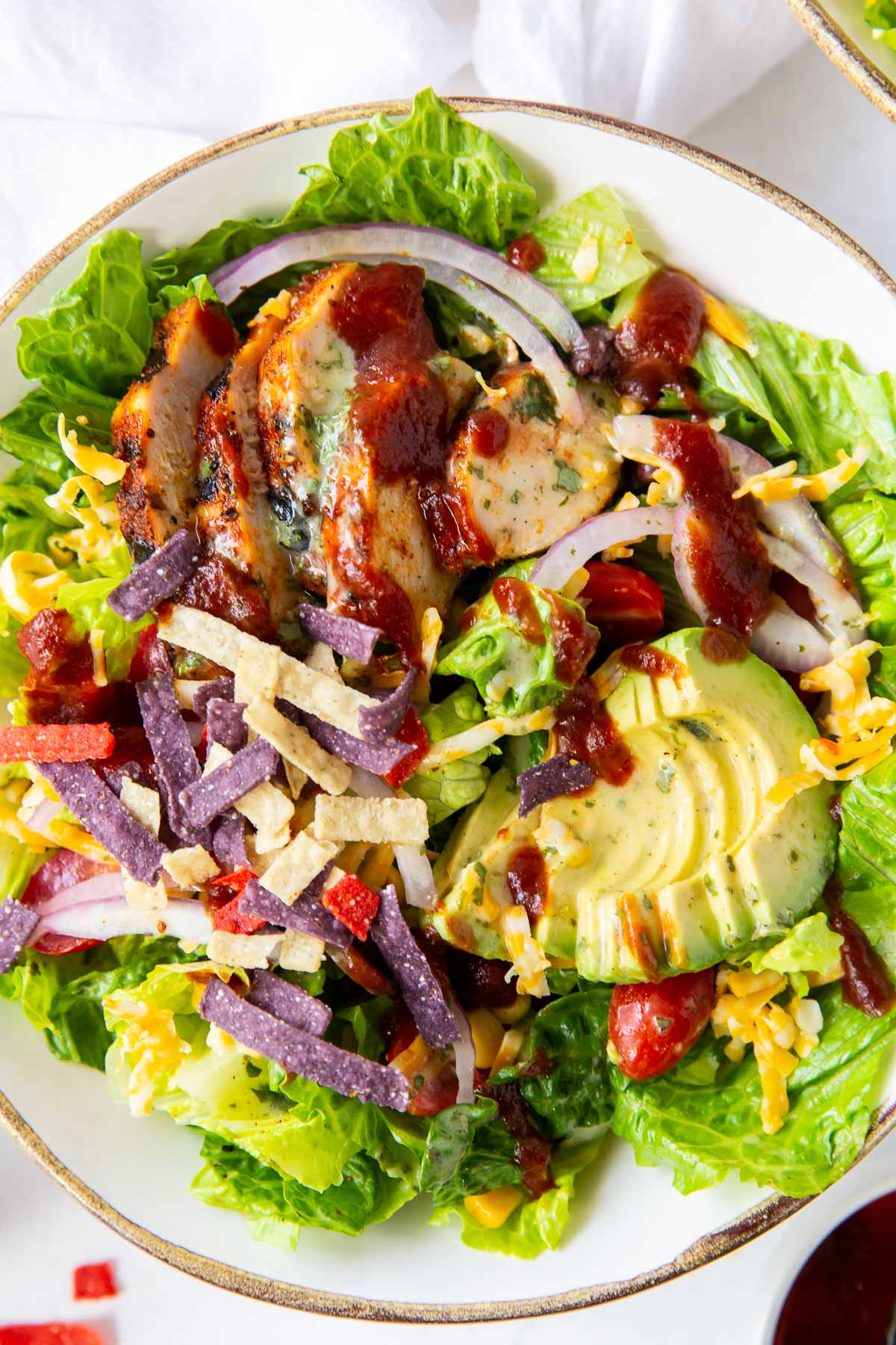 close up of bbq chicken salad on a plate