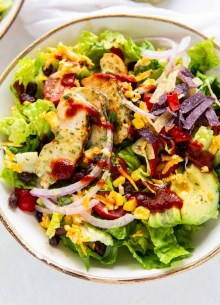 grilled chicken salad drizzled with bbq sauce and cilantro lime dressing