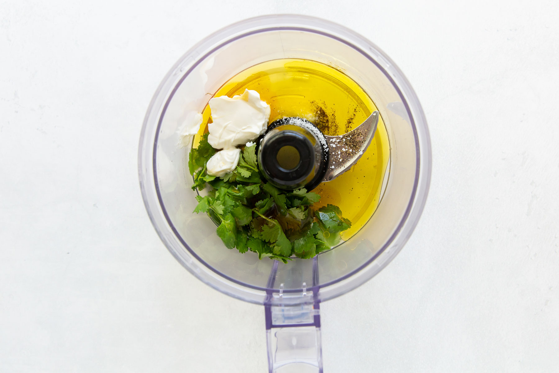 ingredients for cilantro lime dressing in food processor