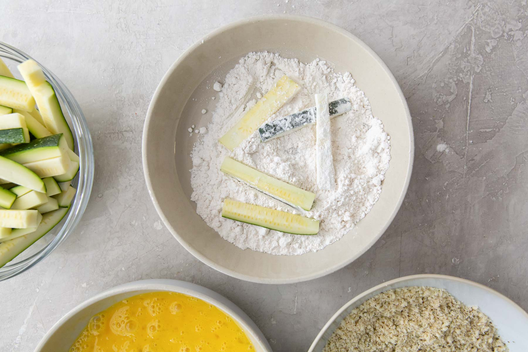 coating zucchini in flour