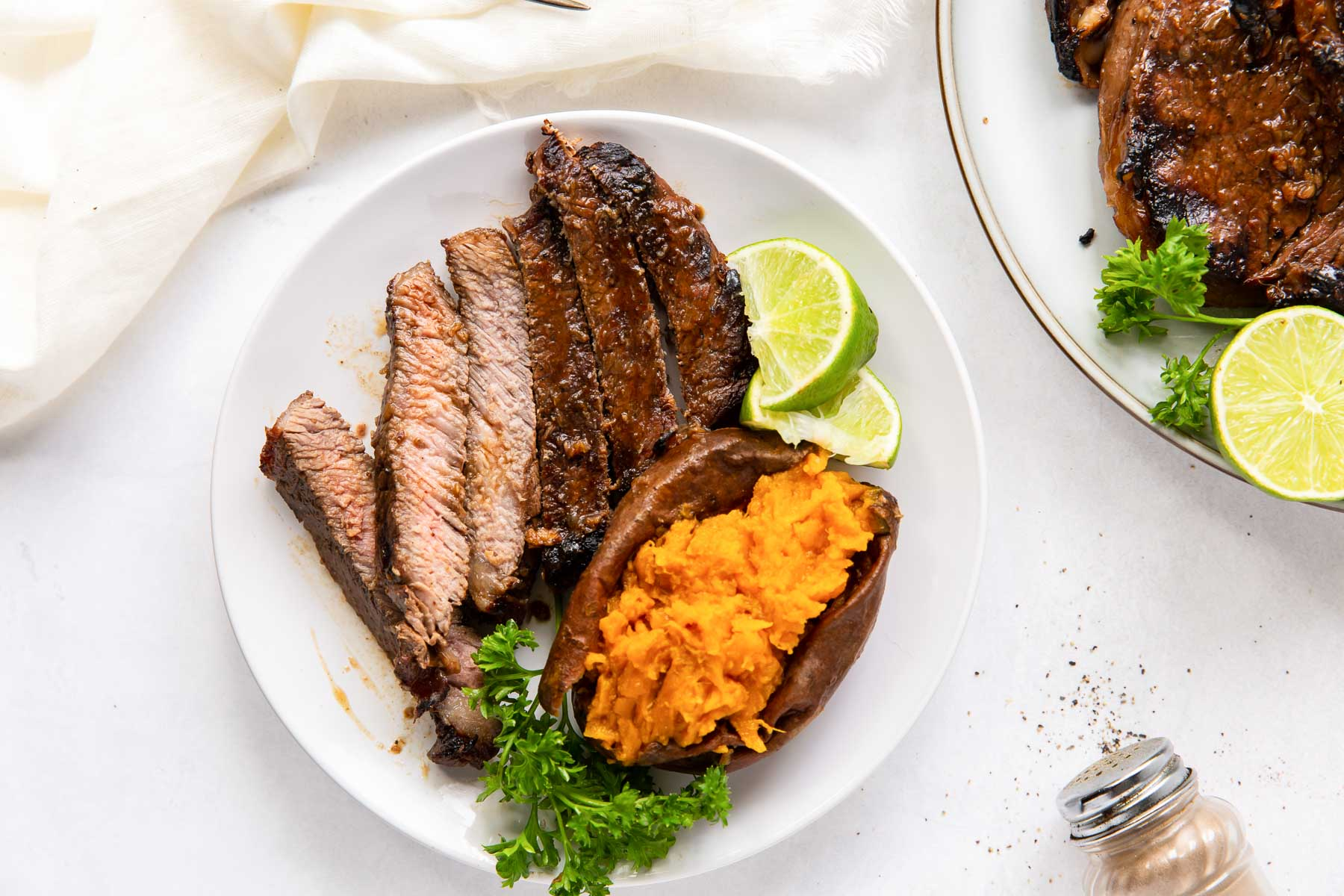 steak sliced and served with baked sweet potato