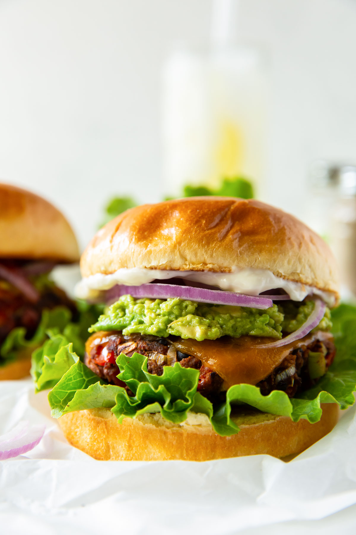 black bean burger with lettuce, cheese, red onion, guacamole and mayo