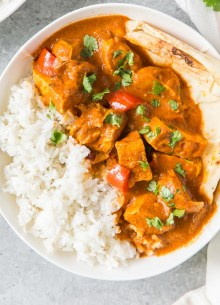 instant pot butter chicken served in a bowl with white rice and naan bread
