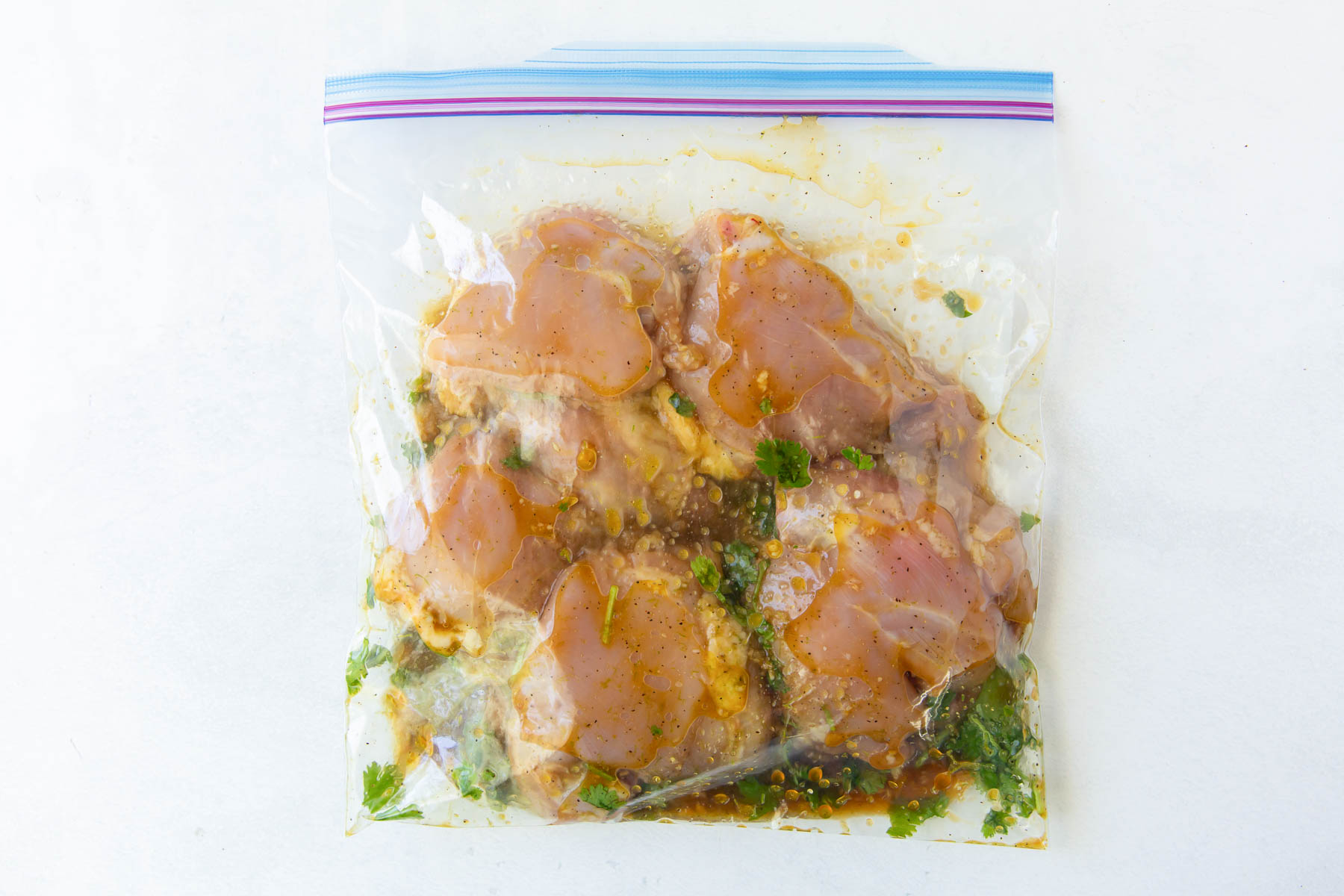 chicken and marinade in a zip-top plastic bag