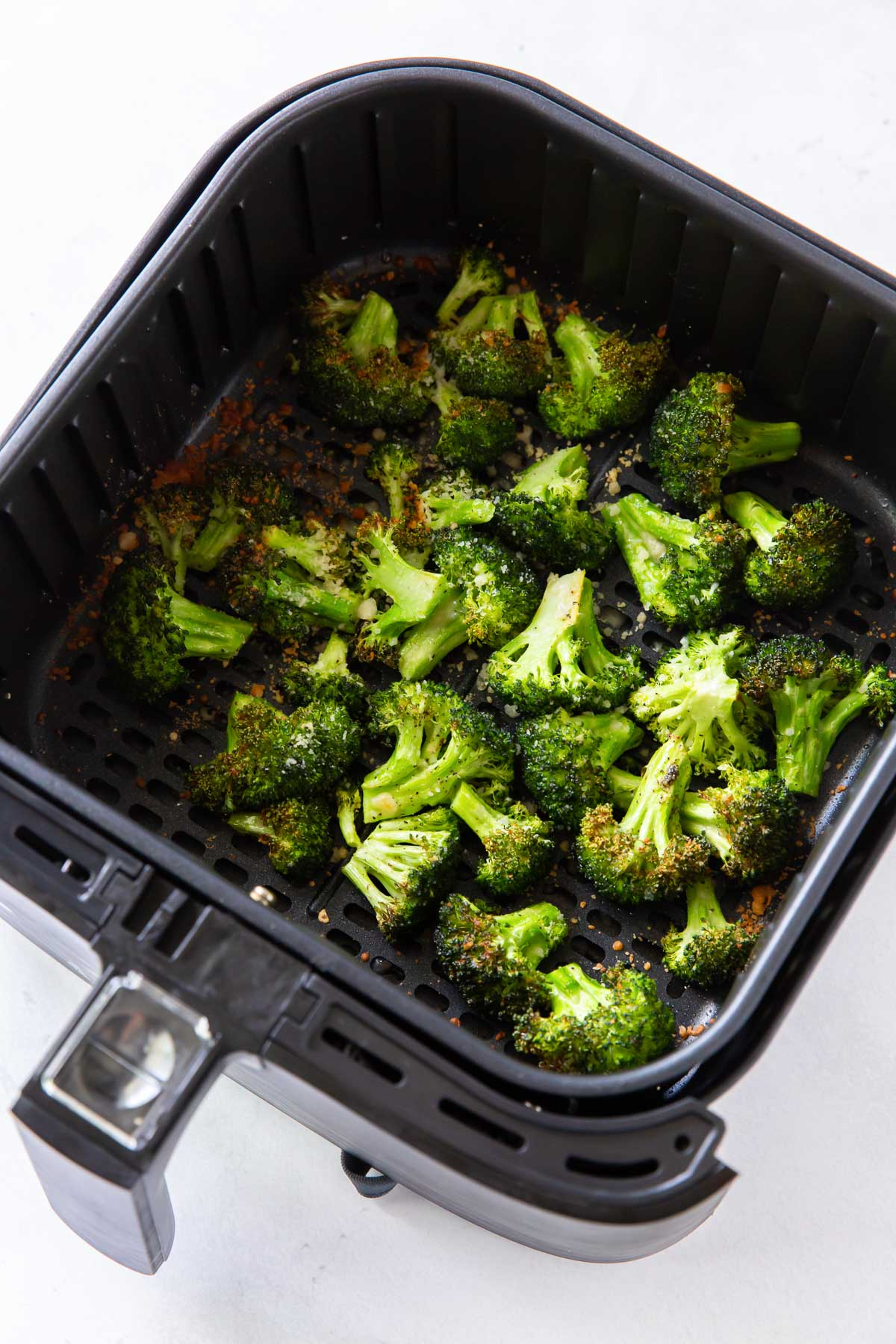cooked broccoli in air fryer basket