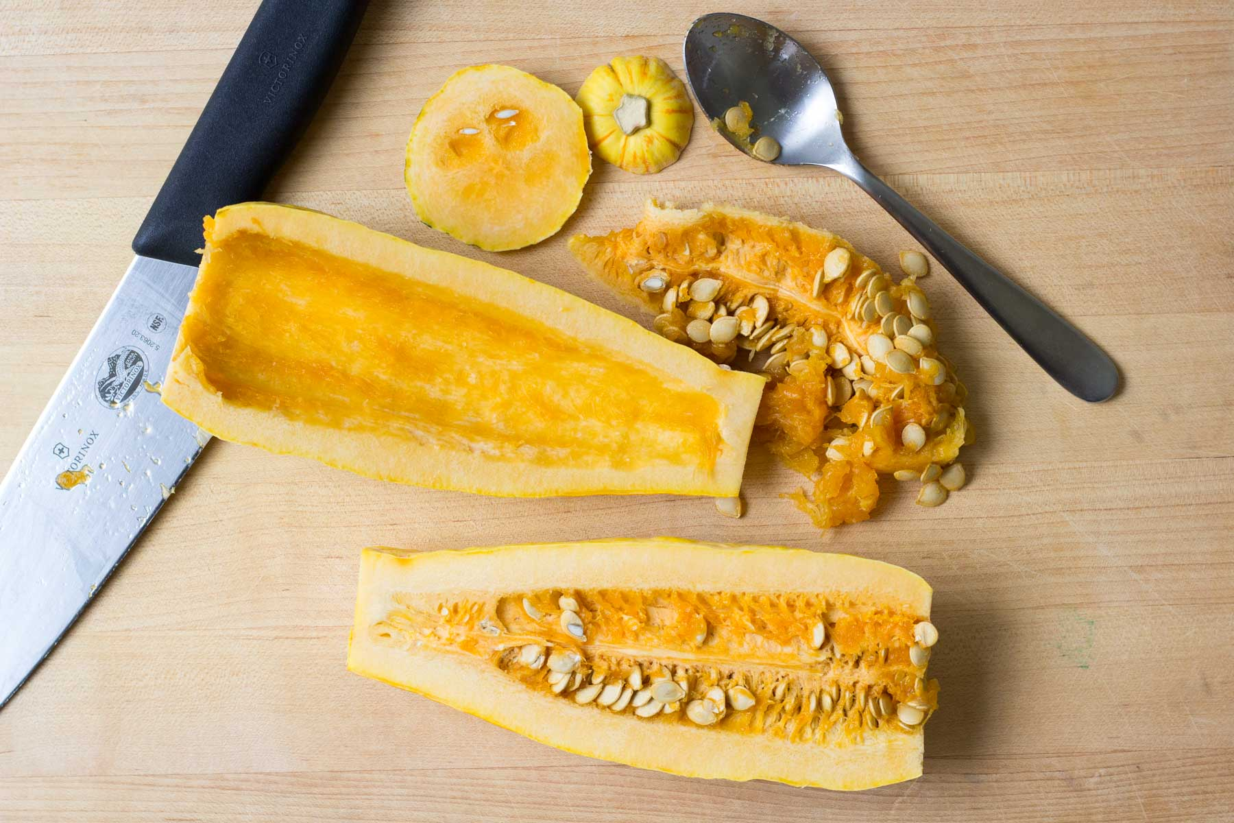 squash halves with seeds scooped out of one half