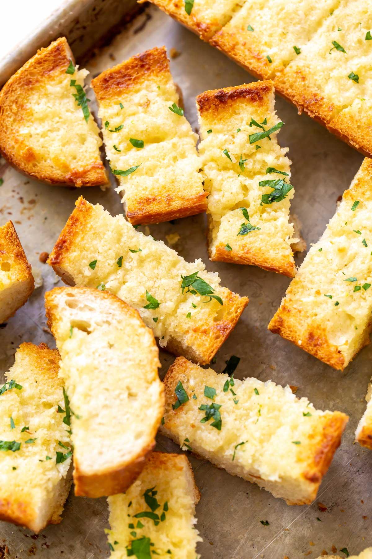 sliced garlic bread on a baking sheet