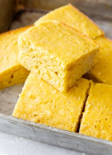 slices of cornbread in a metal baking pan