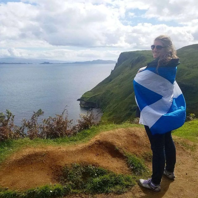 Standing on the cliffs of the Scottish Highlands