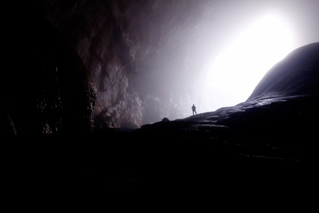 Person in large cave