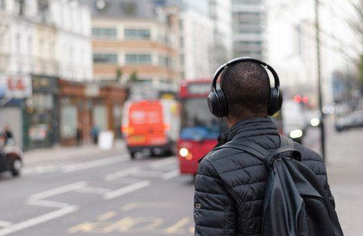 Man with headphones on city street