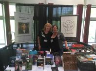 Me and fellow CT author Stacey Longo Harris at the Books and Boos booth. Photo by Jason Harris.