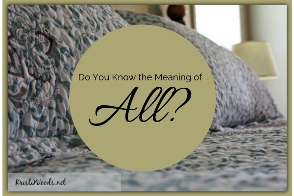 A bedspread with the words Do You KNow the MEaning of All? written over it in a gold circle