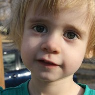 Soothe A Child: Little girl looking into the camera