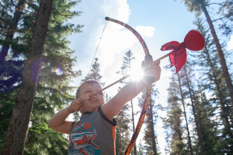 My younger warrior shooting his Two Brothers bow and arrow while camping.