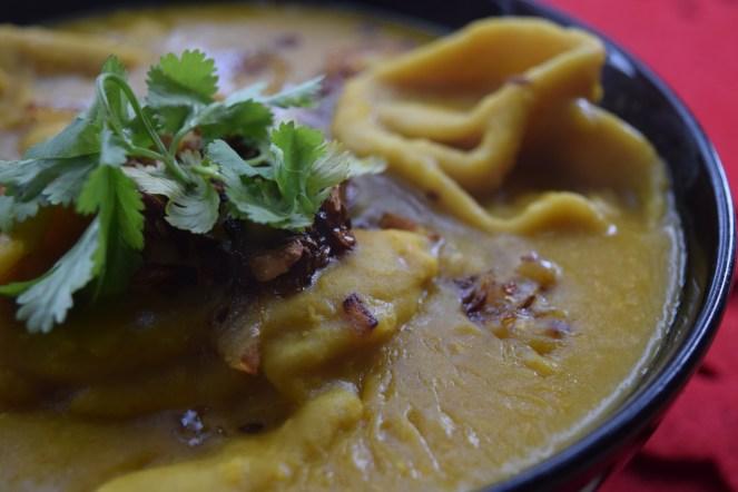 Wheat dumplings in Red lentil soup