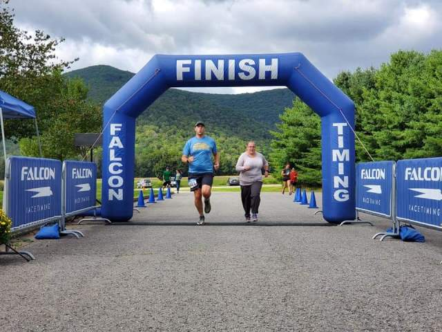 Running through the finish with my wife