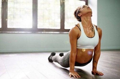 A position of a cobra yoga woman exercising