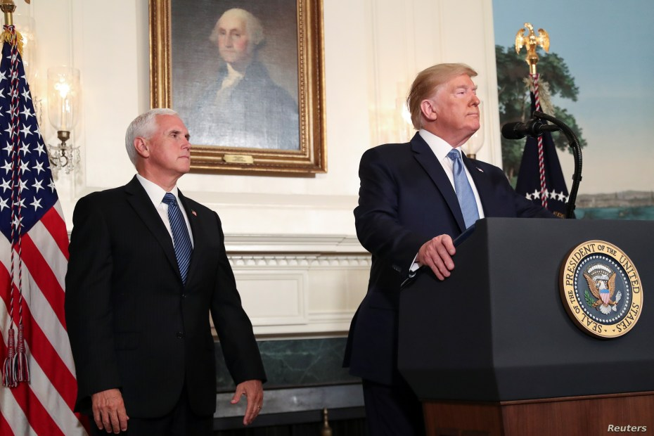 President Donald Trump speaks about the shootings in El Paso and Dayton as Vice President Mike Pence looks on in the Diplomatic Room of the White House in Washington, Aug. 5, 2019.