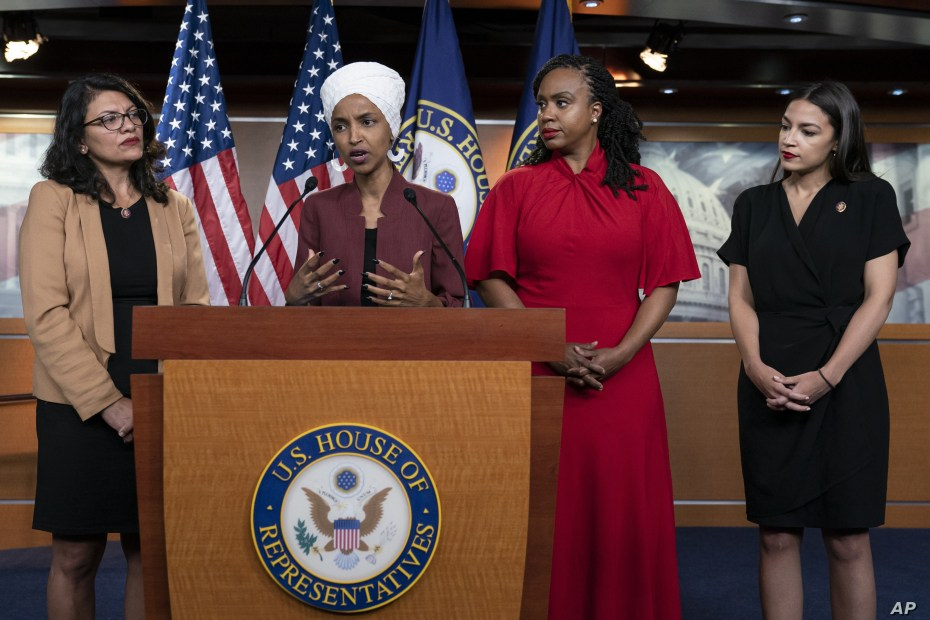 From left, U.S. Reps. Rashida Tlaib, Ilhan Omar, Ayanna Pressley and Alexandria Ocasio-Cortez respond to base remarks by President Donald Trump, at the Capitol in Washington, July 15, 2019. Tuesday, the House voted to condemn Trump for his comments.