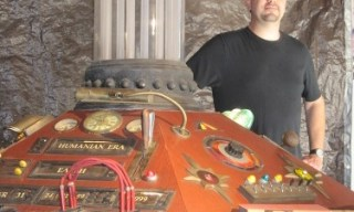 Paul Salamoff poses with his fully restored TARDIS console.