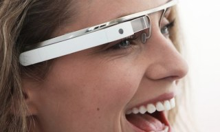 "Google's GLASS heads up display augmented reality ""glasses""."