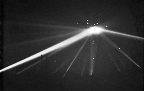 Feb. 25, 1942: Searchlights converge on unknown object over Los Angeles in the early morning hours. Over 1400 rounds of anti-aircraft rounds were fired, with rounds with many rounds landing on the ground. This is an unretouched version.