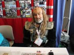 This friendly Klingon will show you the way of honor at his fan table.