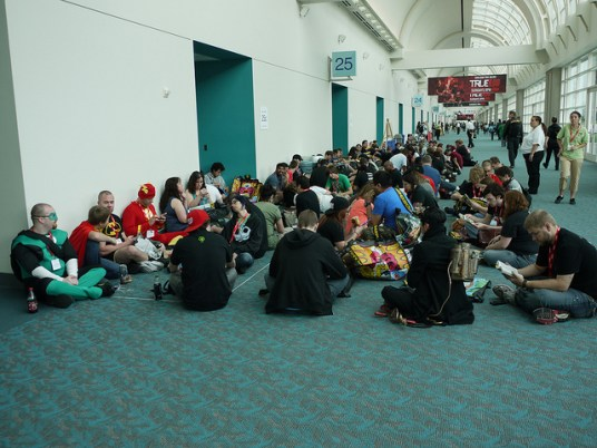 Con-goers wait in a small line for one of the small rooms.