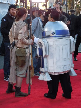 "Lisa Curtis-Saunders as ""Rey"" is interviewed by Guillermo-2-D2 for the Jimmy Kimmel Show."