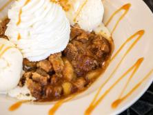 """5) The Cheesecake Factory's Warm Apple Crisp (1,740 calories) Between the apples, """"delicious crispy nutty topping,"""" two scoops of ice cream, small mountain of whipped cream, and caramel sauce, you're looking at 1,740 calories—more than any cheesecake on the menu. In fact, you can eat TWO slices of the original cheesecake instead. Gross. IMAGE: Cheesecake Factory website"""