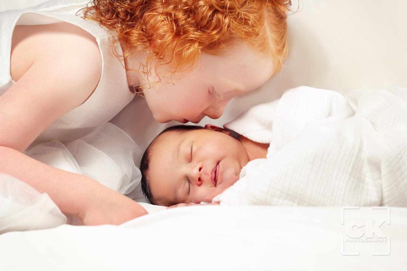Chris Kryzanek Photography - newborn with sister