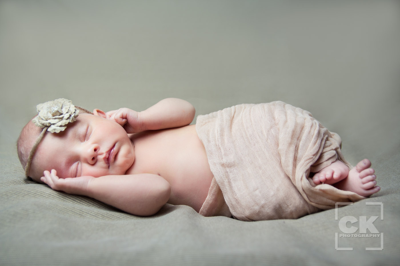 Chris Kryzanek Photography - newborn wrapped with flower headband