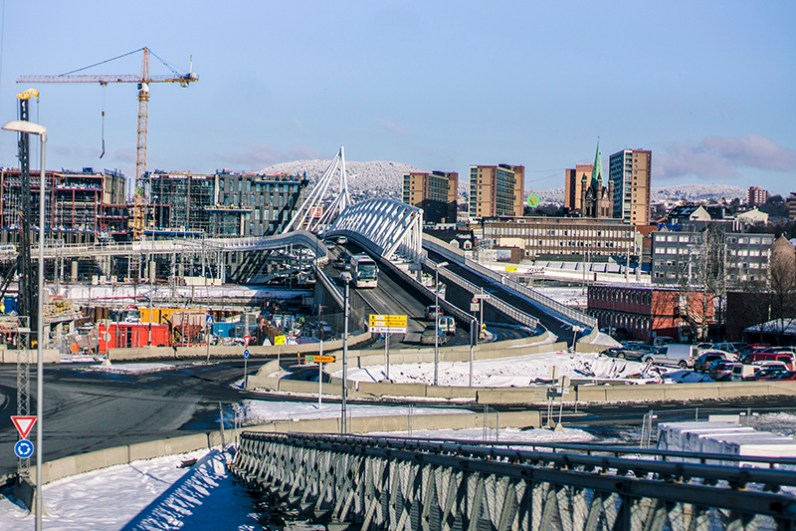 Oslo city: modern bridges and skyline and historical towers in the horizon