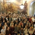 Theatre in Our Schools Day photograph of the students with the mural in Topeka, KS.