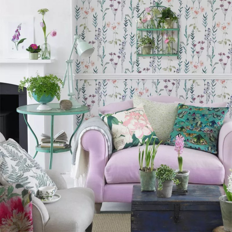 White living room with floral wallpaper and lavender love seat