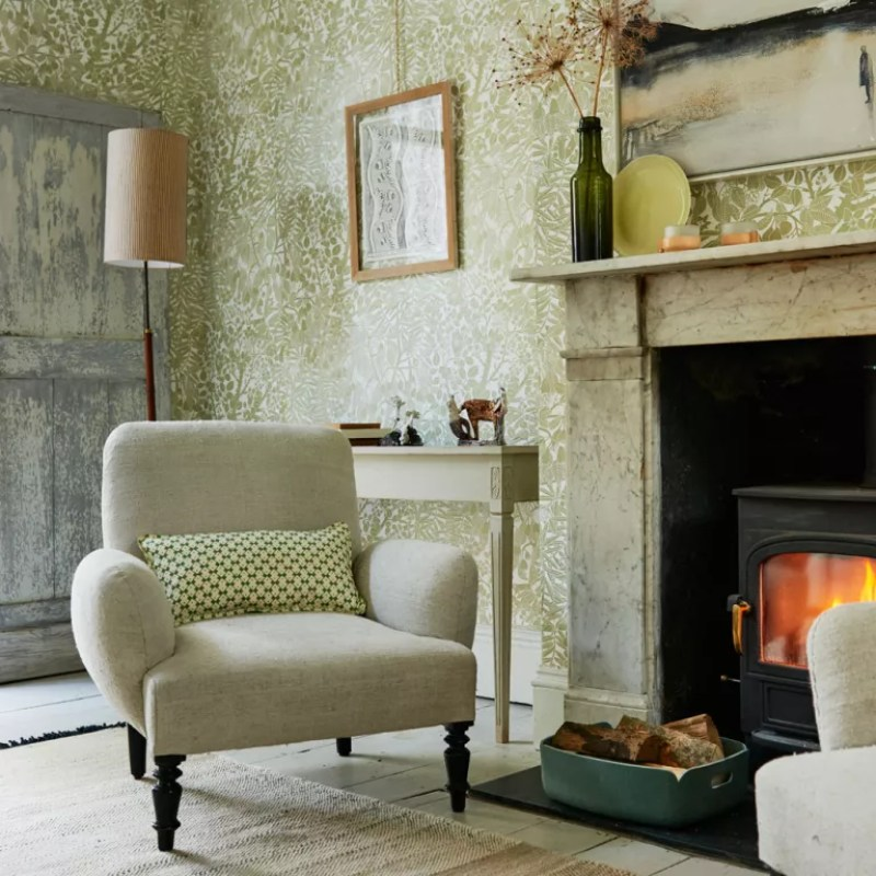 Country living room with leafy green print wallpaper