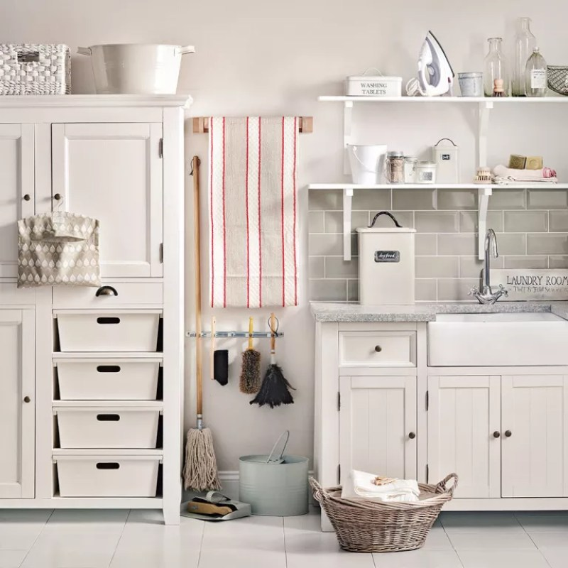 a laundry room with cabinets, drawers and storage boxes