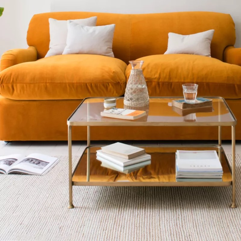 Wonder Boy coffee table in front of an orange sofa - loaf