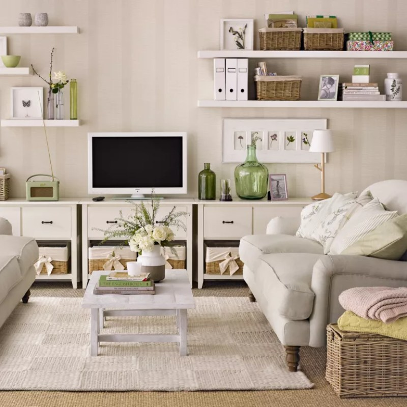 neutral living room with wall of storage units and floating shelves