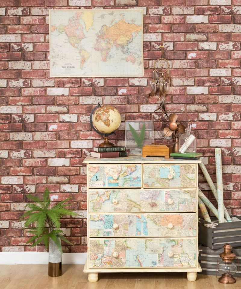 Faux brick wallpaper in living room with world map papered chest of drawers