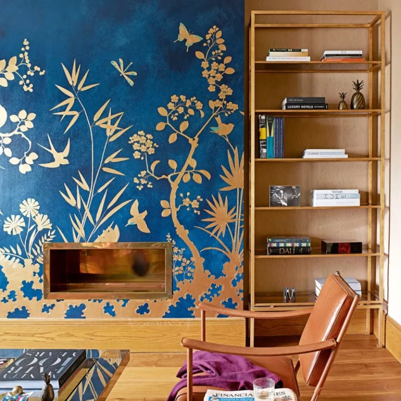 Blue and neutral Living room with statement blue and gold wallpaper on fireplace wall