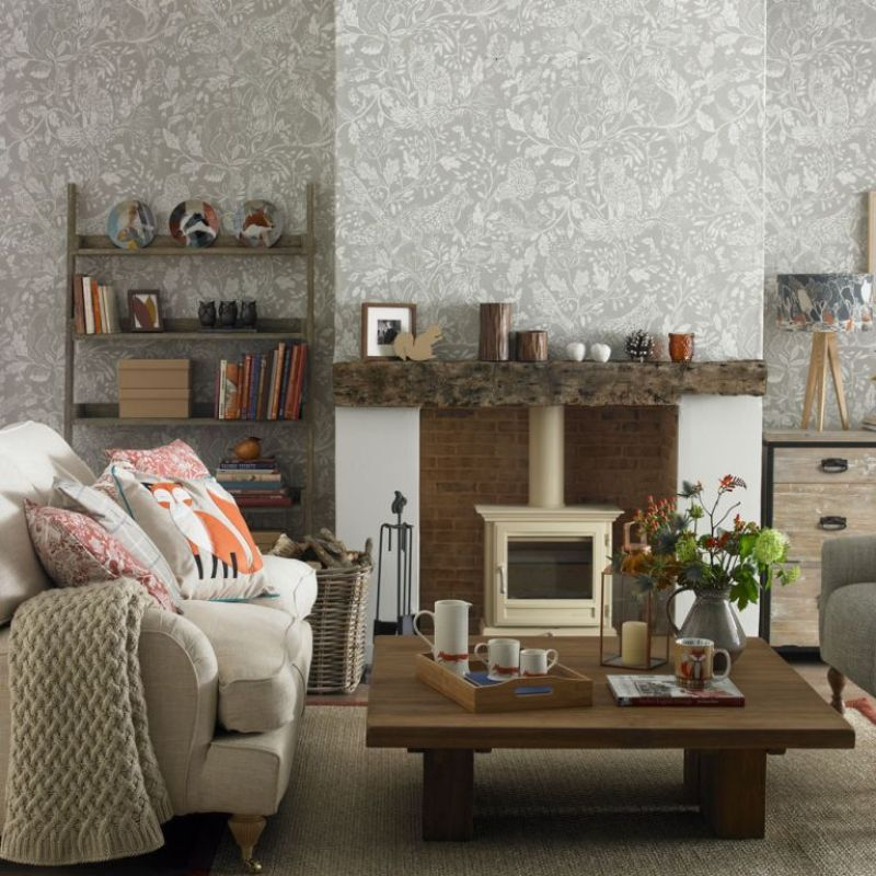 Country grey living room with grey woodland wallpaper rustic wooden furniture and log burner