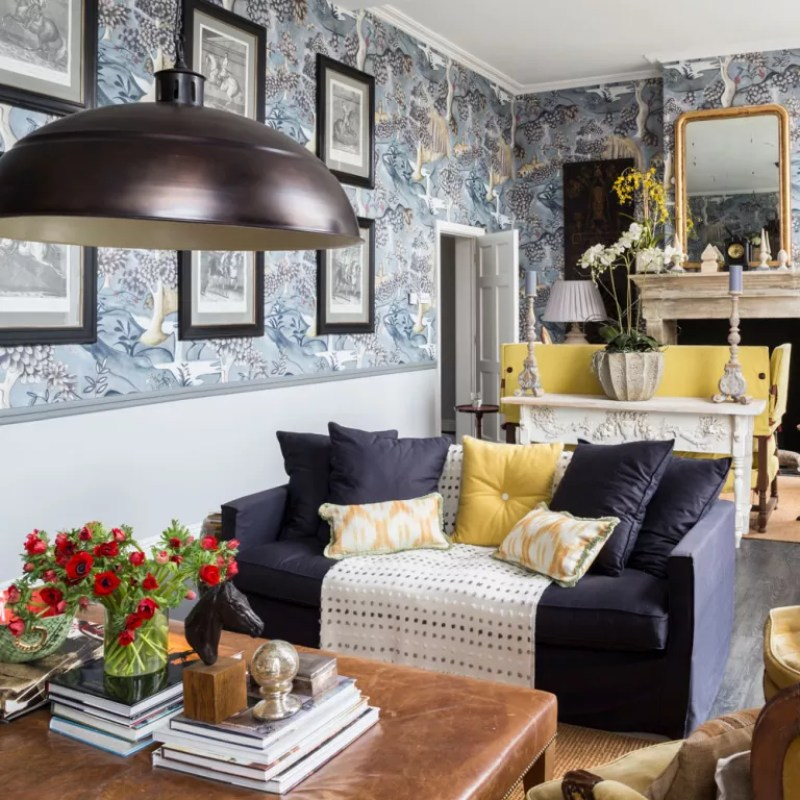 Living room with dining area wallpapered above wall panelling at half height