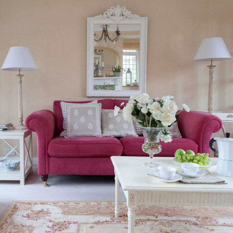 Neutral living room with raspberry pink sofa