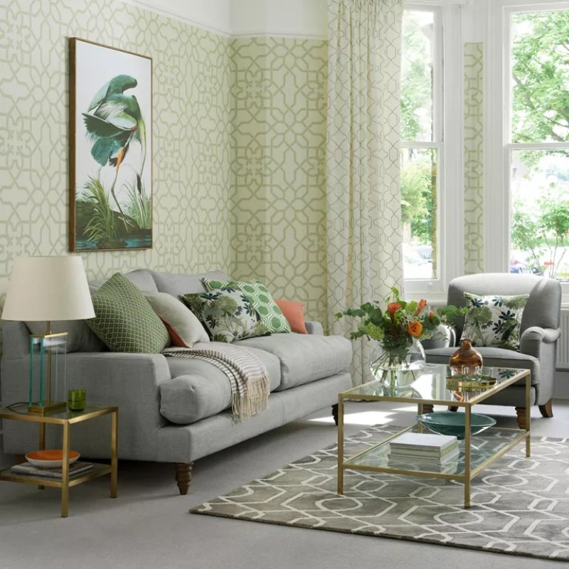 green living room with geometric wallpaper and matching patterned curtains