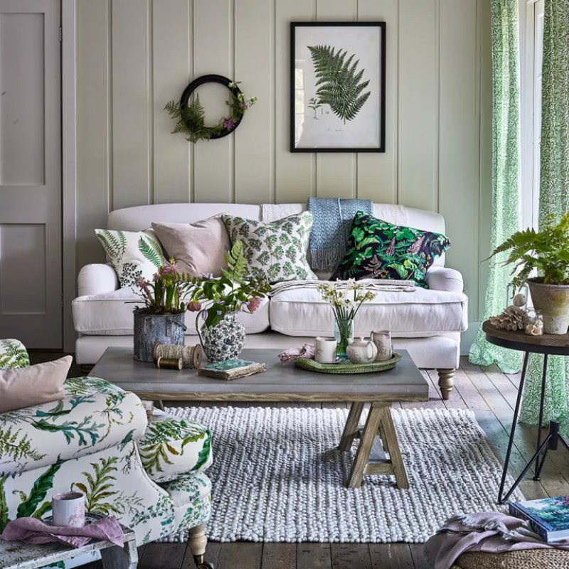 Country-living-room-with-foliage-prints-and-rustic-wooden-furniture